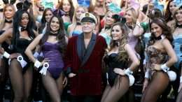 LOS ANGELES, CA - JANUARY 16:  Hugh Hefner (C) poses with Playboy Bunnies Playmate of the Year 2013 Raquel Pomplun (2nd L) and Miss December 2009 Crystal Hefner (2nd R) at Playboy's 60th Anniversary special event on January 16, 2014 in Los Angeles, California.  (Photo by Rachel Murray/Getty Images for Playboy)